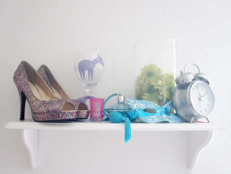 Sarah's room: Glittery high heels, a carnival mask and assorted treasures on display