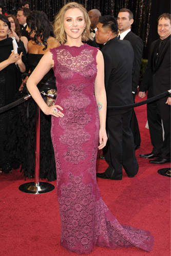 Scarlett Johansson in a purple Dolce & Gabbana gown on the 2011 Oscars red carpet