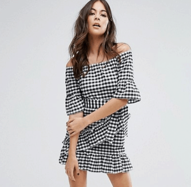 woman in gingham print dress