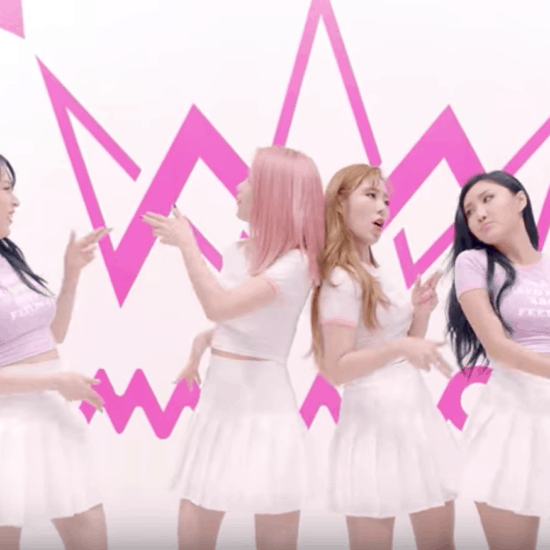 Mamamoo Yes I Am fashion: The girls wear pink and purple tops with white skirts in front of a pink background in the music video