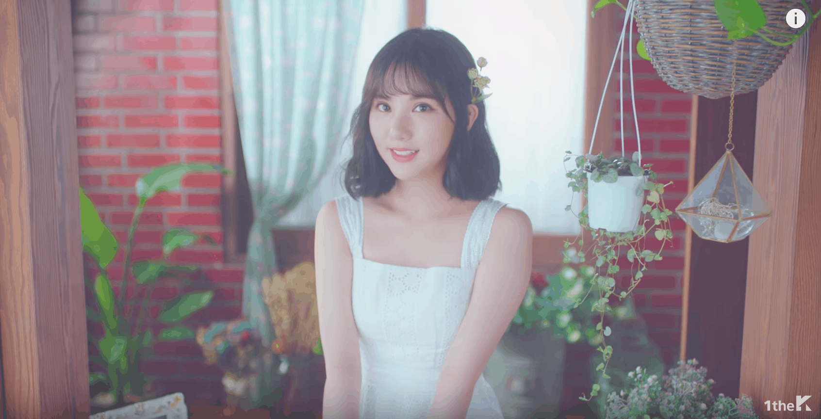 GFRIEND Love Whisper music video: Girl wears a white dress and a flower in her hair