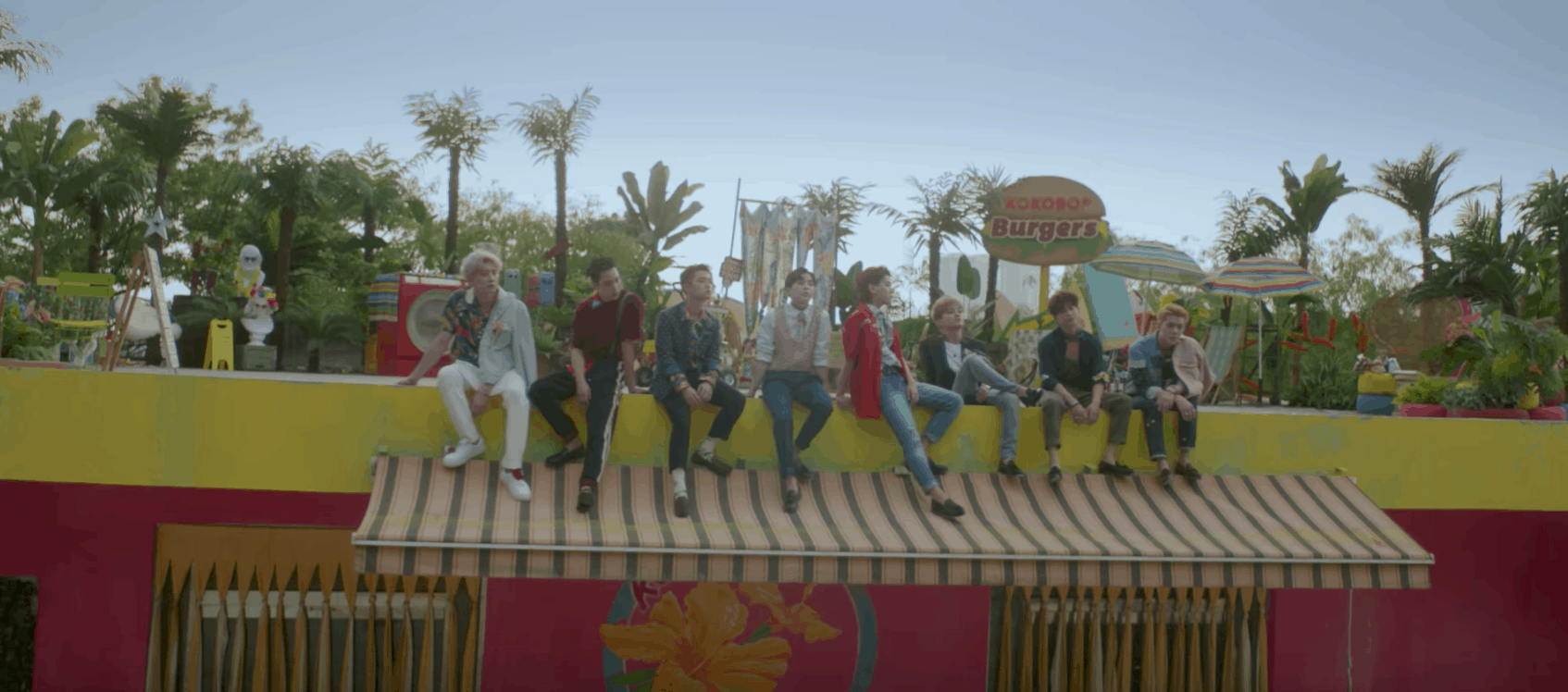 EXO Ko Ko Bop video - The boys sitting on the roof of a burger joint