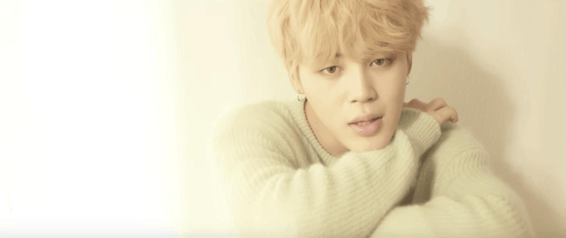 BTS Serendipity music video: Jimin wearing a fuzzy gray sweater