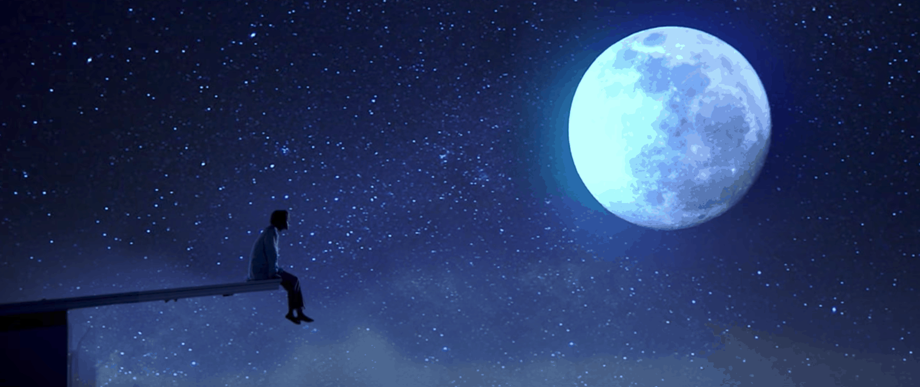 BTS Serendipity music video: Picture of a man sitting on the edge of a rock jutting out into the sky, under a bright full moon