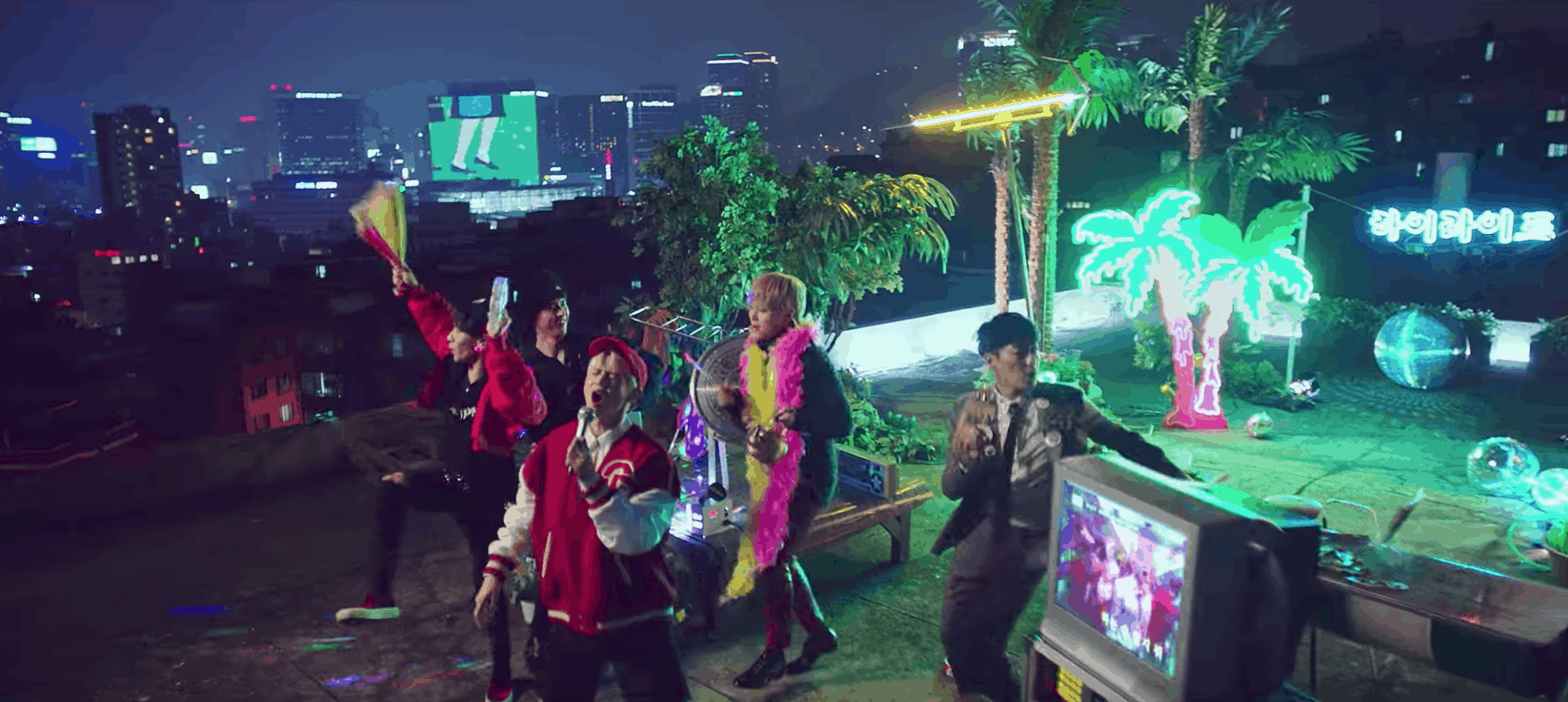 Highlight can be better music video fashion: The boys performing on a rooftop with palm trees