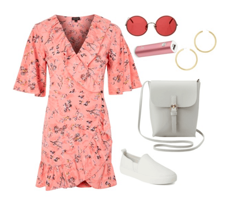 Coachella outfit idea: Floral dress paired with white slip on sneakers. Accessories include a crossbody bag, sunglasses, portable charger and hoop earrings.