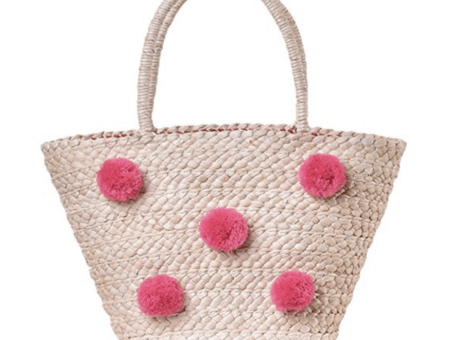 Straw pink polka dot bag.