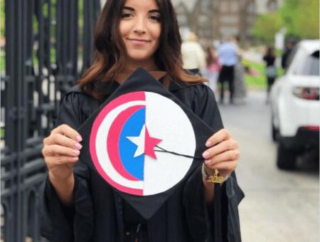 Girl holding graduation cap