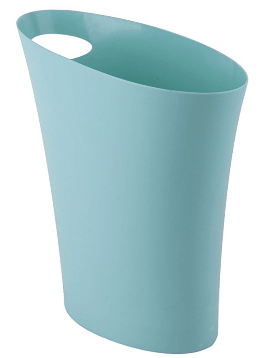Umbra skinny blue dorm room trash can with handle.