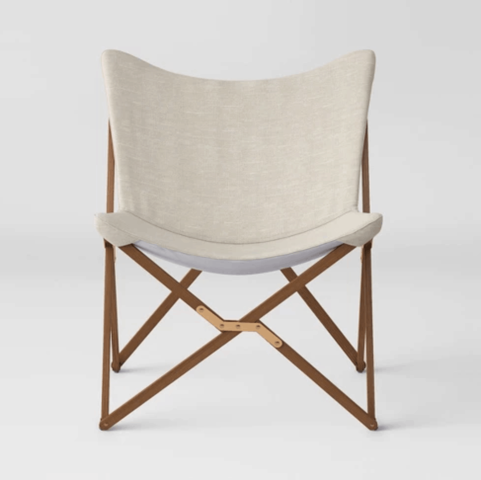 Target wooden midcentury modern butterfly chair with padded seat.