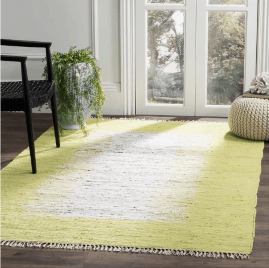 Citron yellow and white woven flat weave rug from Target with fringe edges.