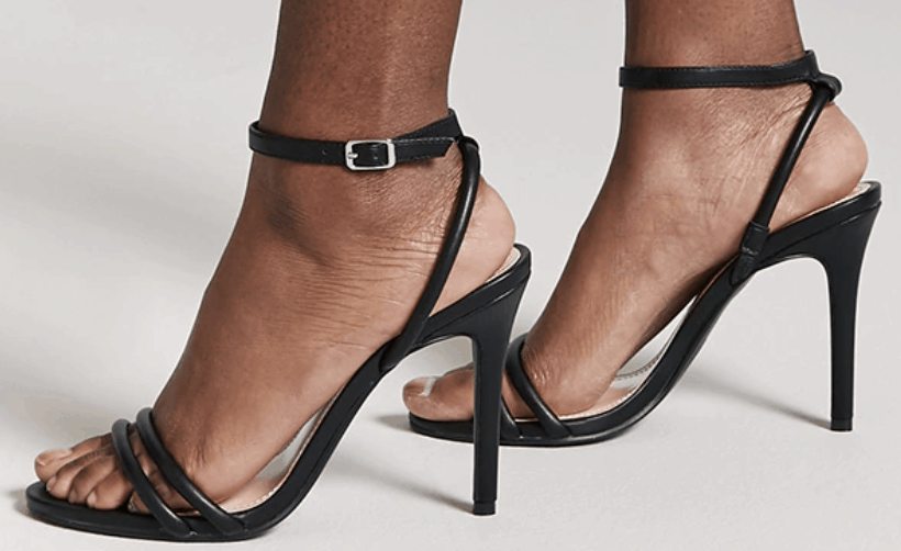 Black faux leather heels.