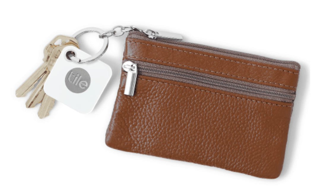 Tile product attached to keys and a brown wallet