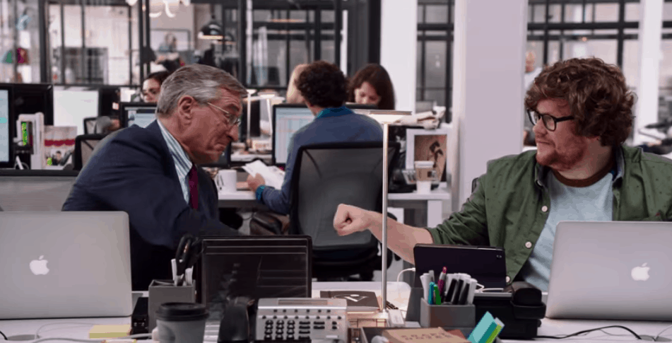 Ben Whittaker and fellow intern in the movie The Intern