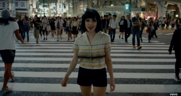 Carly Rae Jepsen shorts and striped button-up