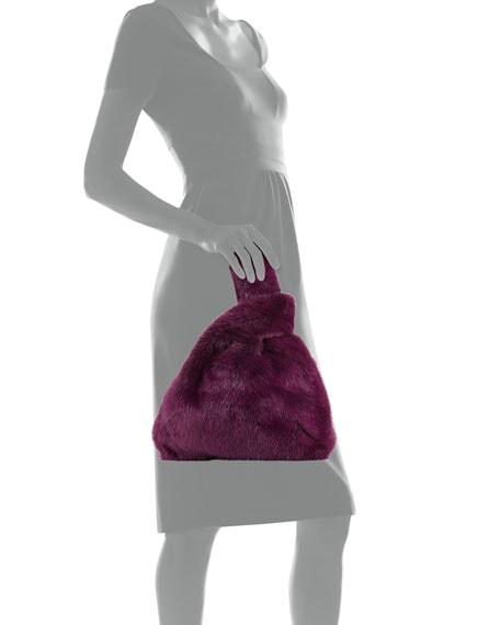 Model showing a Simonetta Ravizza fur bag