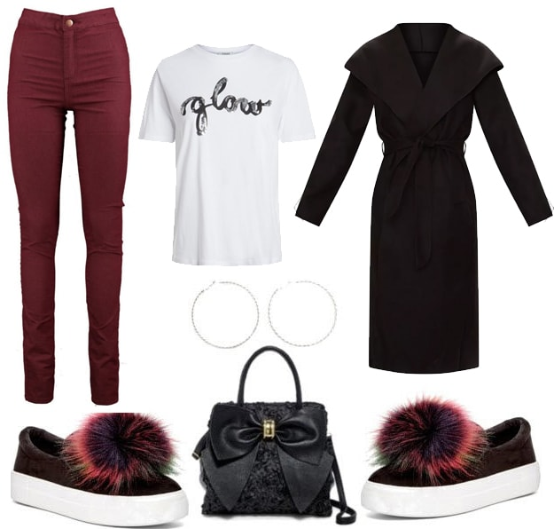 Slogan tee outfit: How to wear a graphic tee shirt with dark red jeans, a long black coat, pom pom sneakers, a top-handle bag and hoop earrings