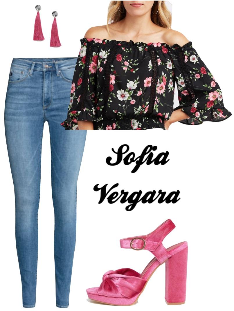 Sofia Vergara Outfit: blue skinny jeans, dark floral off the shoulder top, pink tassel earrings, pink velvet platforms