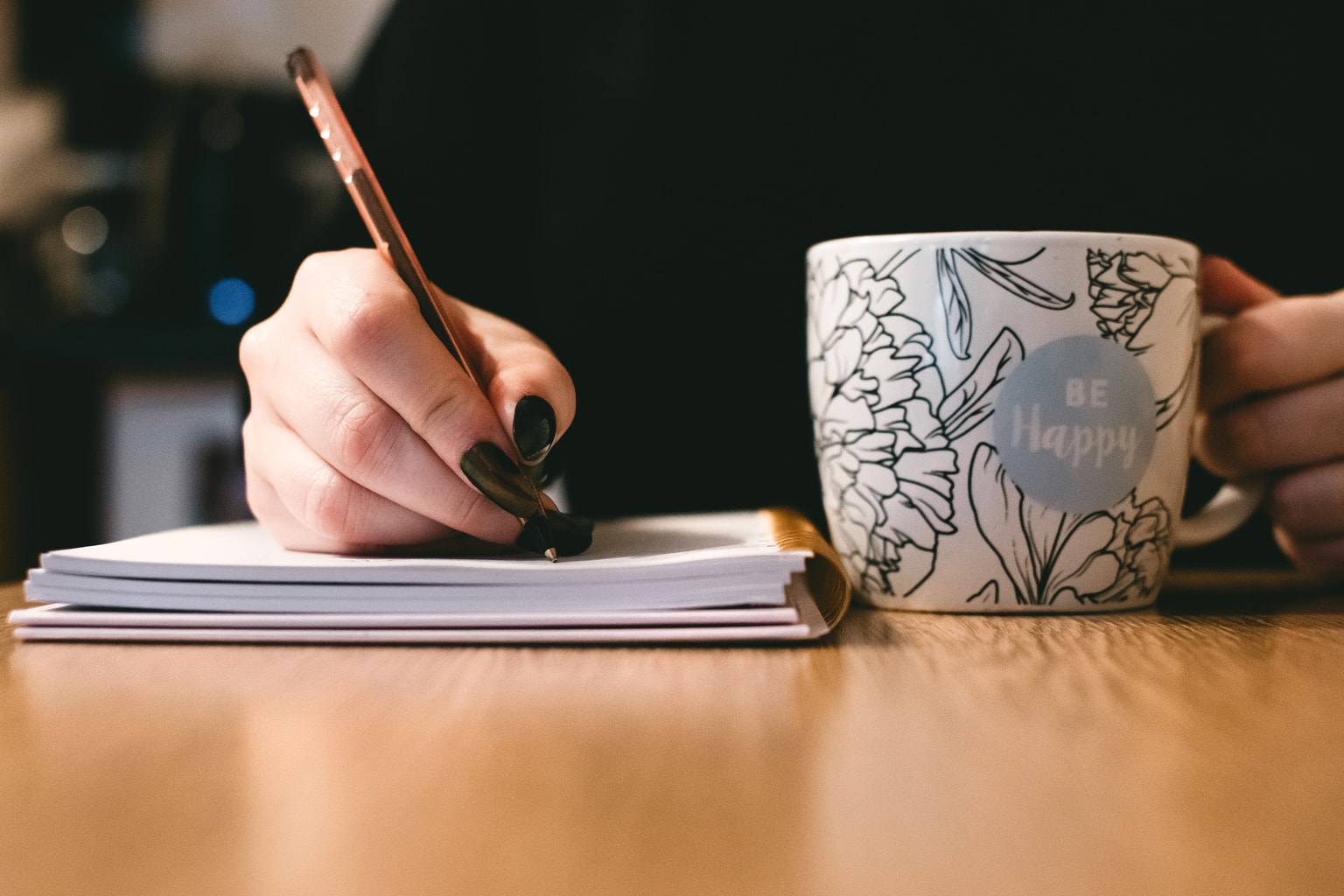journaling-with-a-mug-that-has-a-be-happy-motto