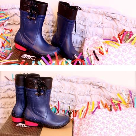 SOREL navy rain boots with pink heels