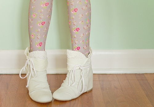 White booties with floral tights