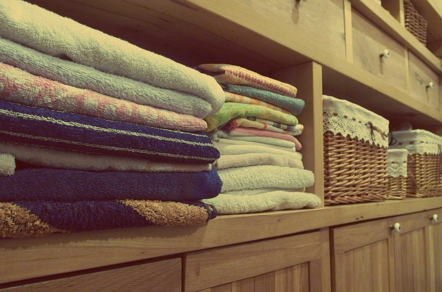 Towels nicely organized on a shelf
