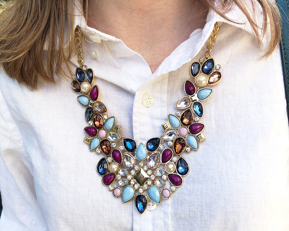Jeweled statement necklace in blue, magenta, turquoise and clear on campus at WVU