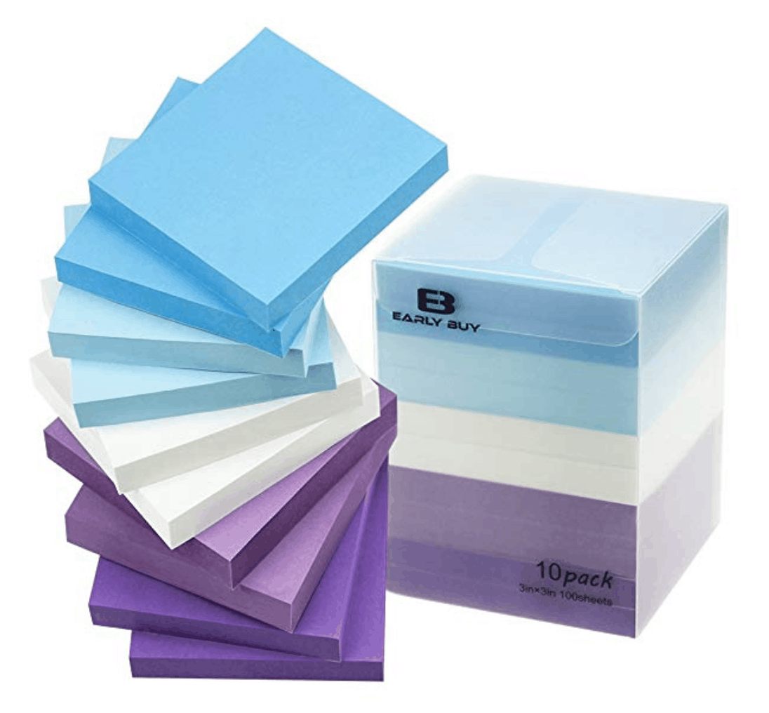 Block of sticky notes in blue, white and purple