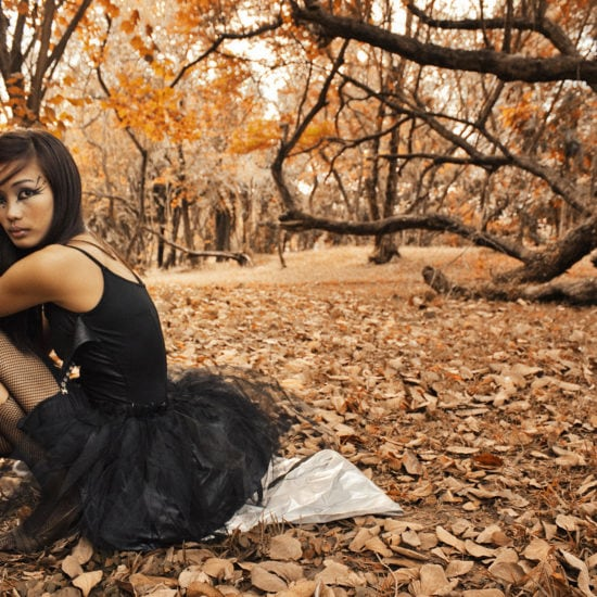 Halloween outfit - picture of a girl wearing a black ballerina outfit outside in the woods