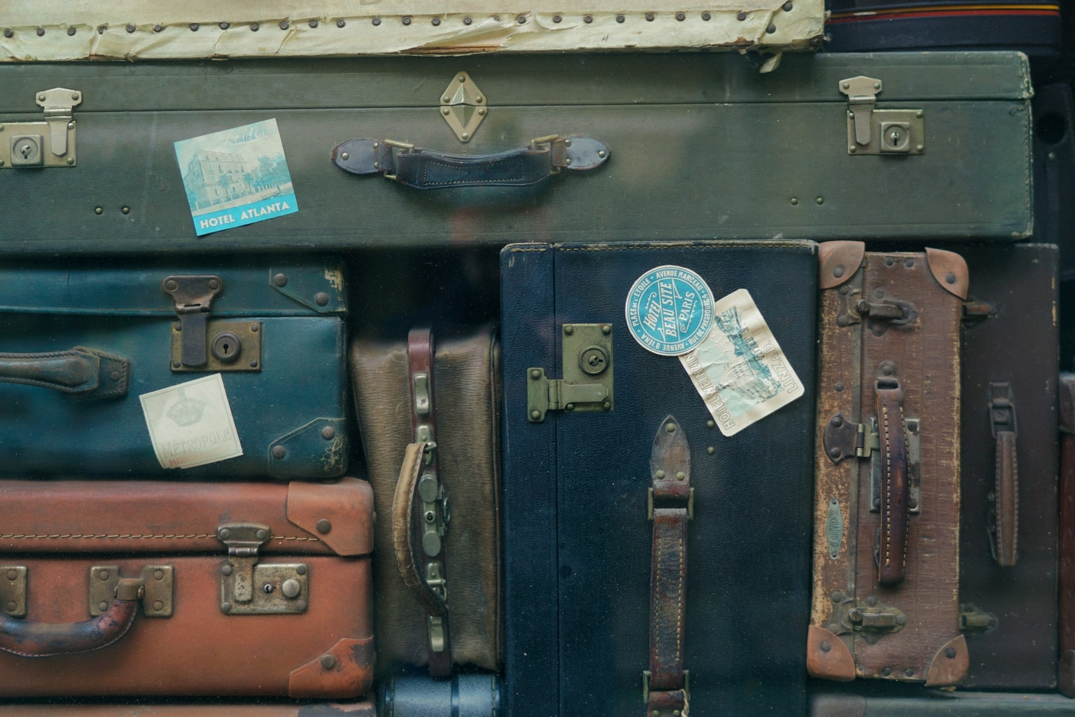 Stack of old fashioned luggage with passport stamps