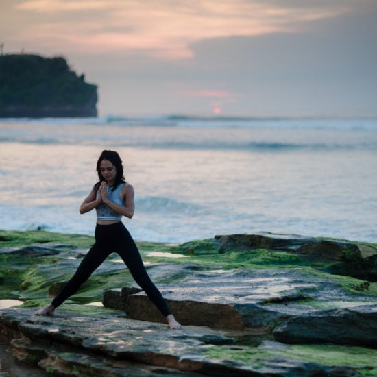 Woman practicing yoga - guide to mindfulness in college