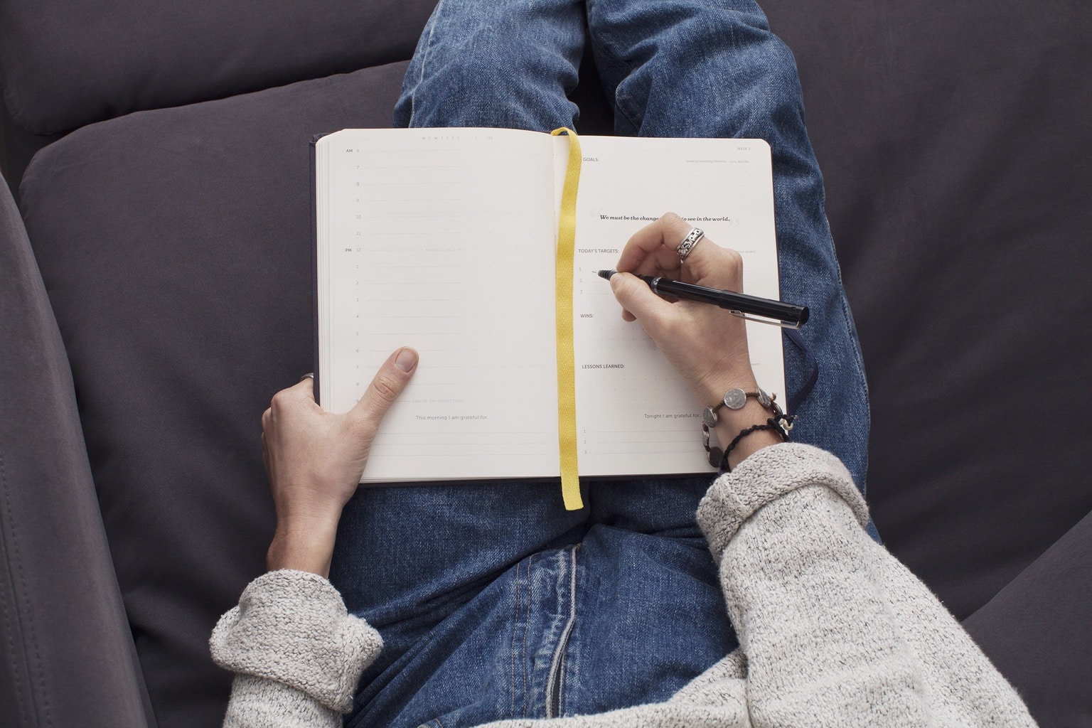 Girl with blue jeans writing in journal