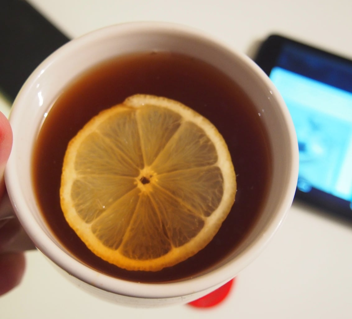 Cup of cider or tea with an orange slice on top