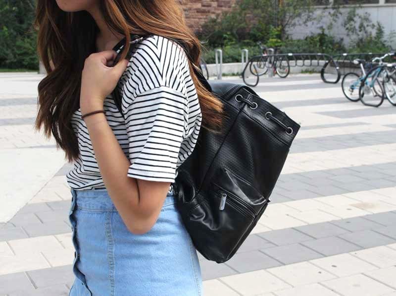 Striped shirt, denim skirt, black bag