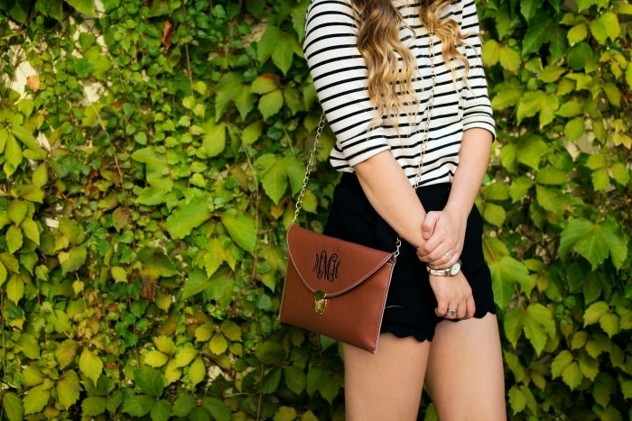 striped top and black shorts