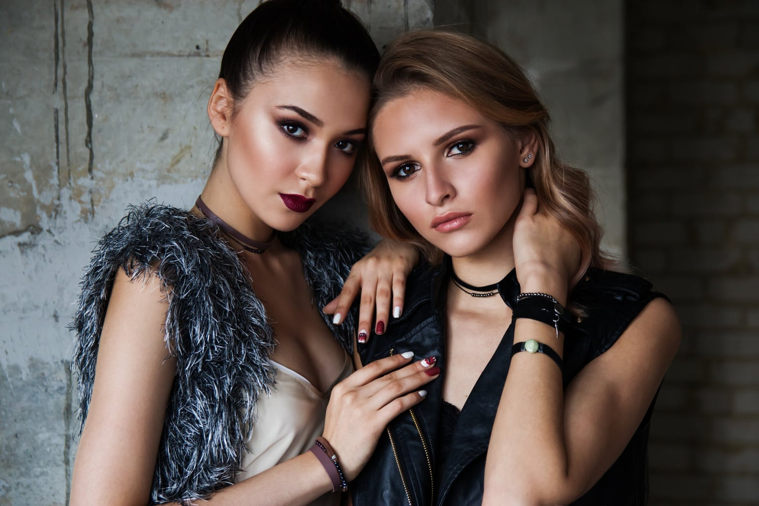 Close-up shot of two women wearing edgy outfits