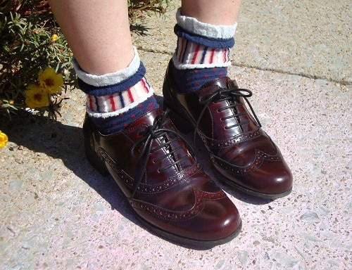 Stylish college student wearing oxfords and printed socks