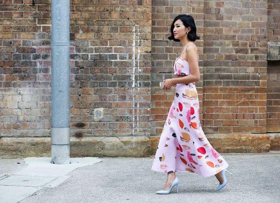 Stylish woman walking down street