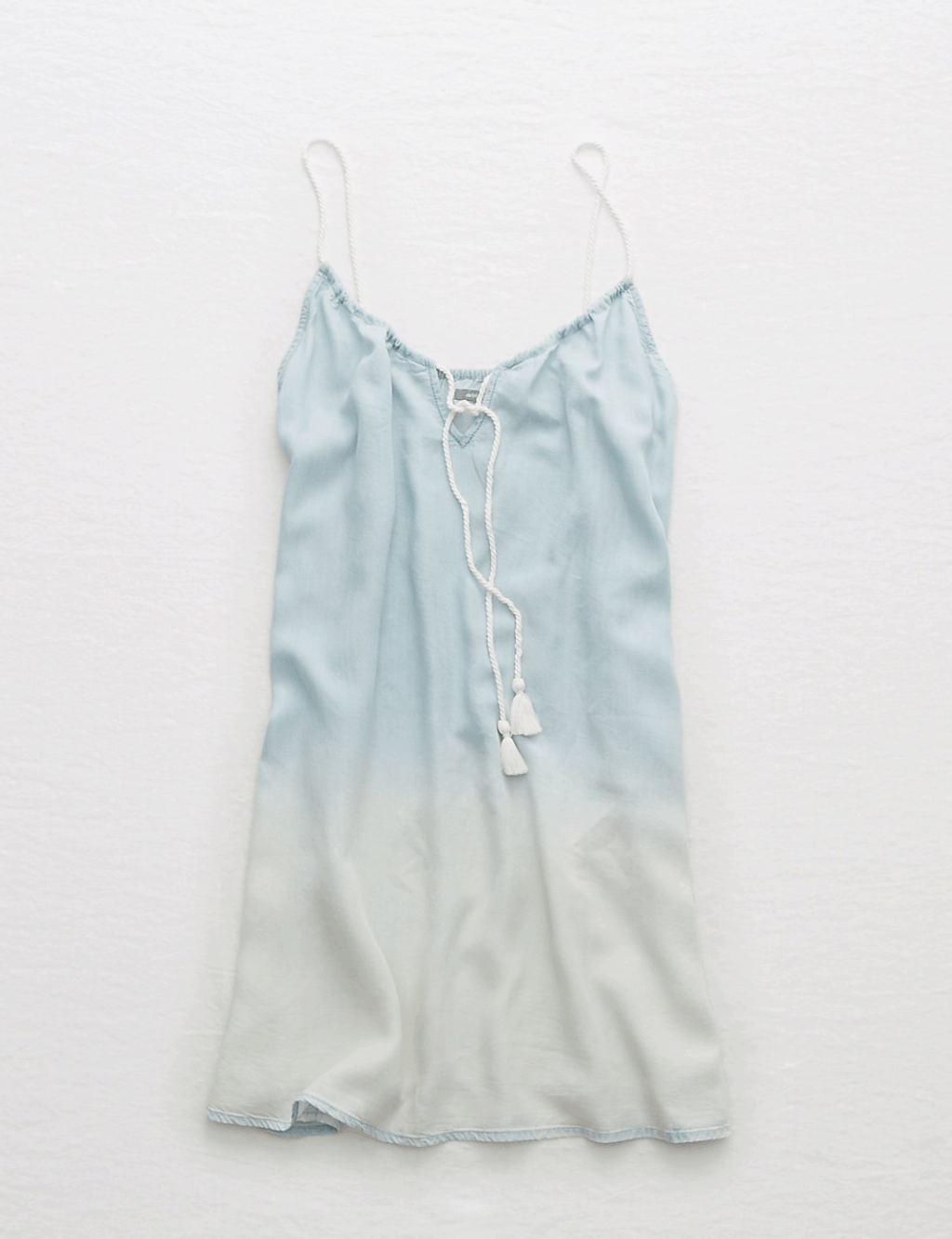 Pale-blue-and-white ombré chambray dress with white twisted front tie with tassels and white twisted straps and keyhole neckline