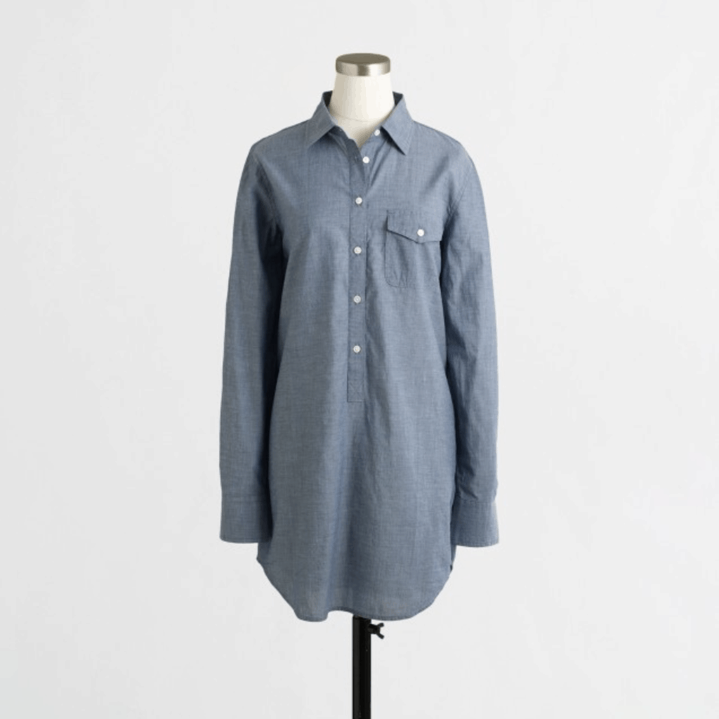 Blue long-sleeved popover tunic with collar and left chest pocket with button