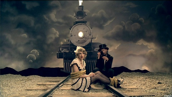 Taylor Swift 'Mean' Music Video Screencap 2 - Taylor on the railroad tracks