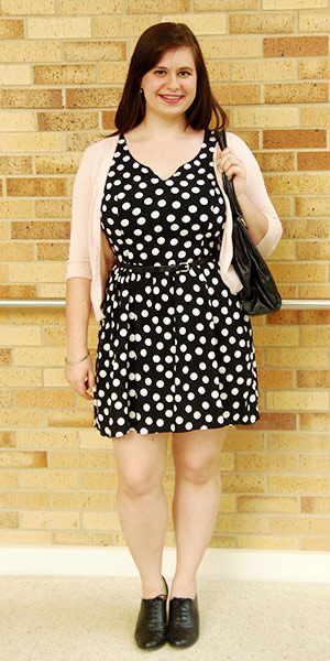 Texas A&M University student fashion - polka dot dress, pink cardigan, oxfords