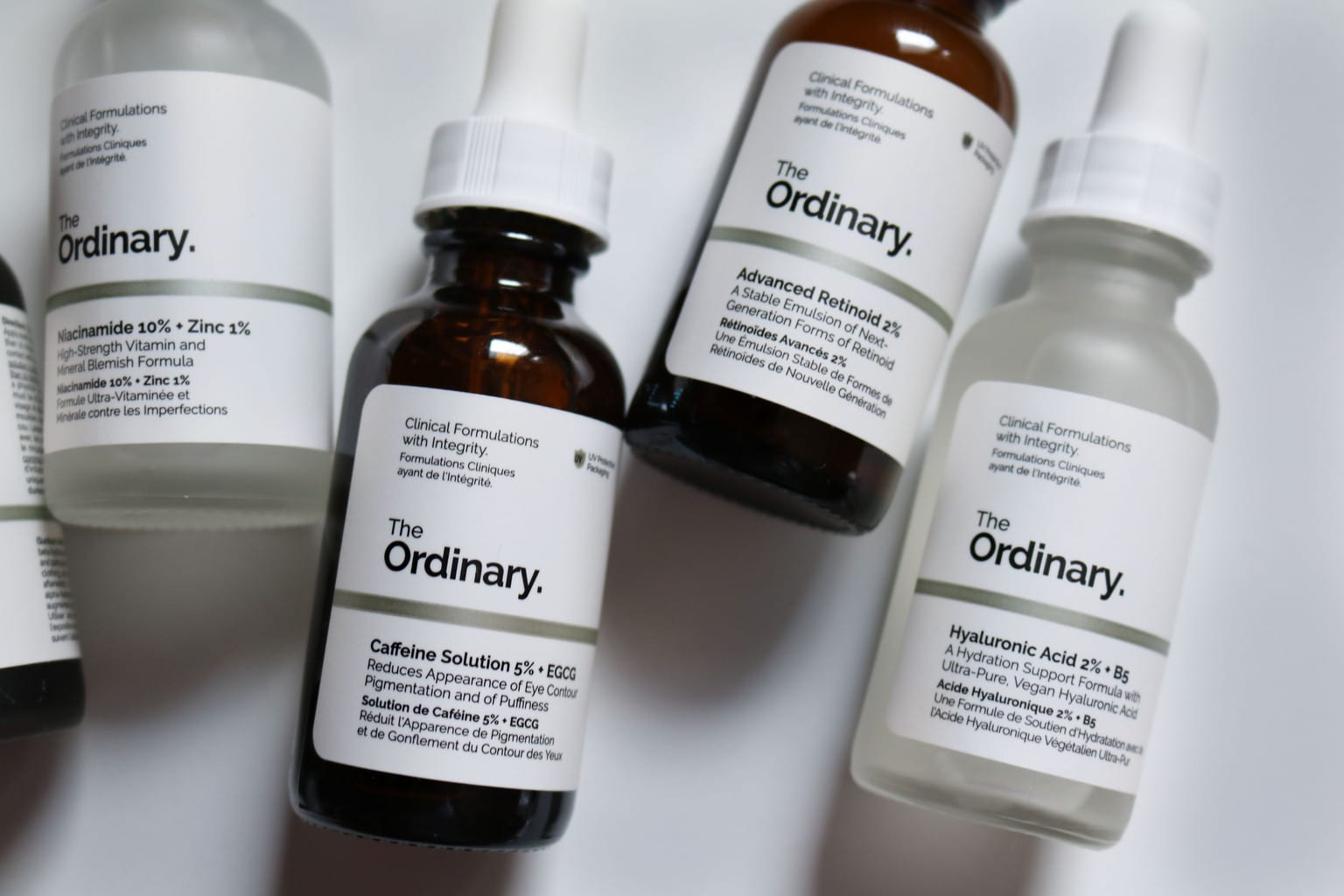 The Ordinary Skincare: Close ups for Caffeine Solution, Advanced Retinoid, Hylauronic Acid bottles