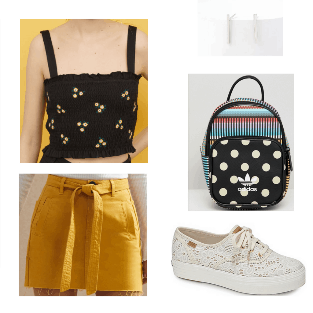 black floral crop top, mustard skirt, silver earrings, black patterned backpack, lace white sneakers