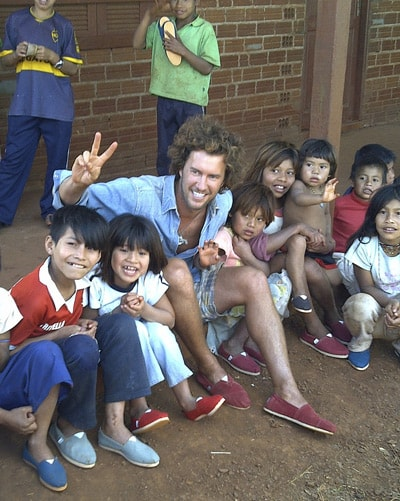 TOMS CEO Blake Mycoskie and children in Argentina