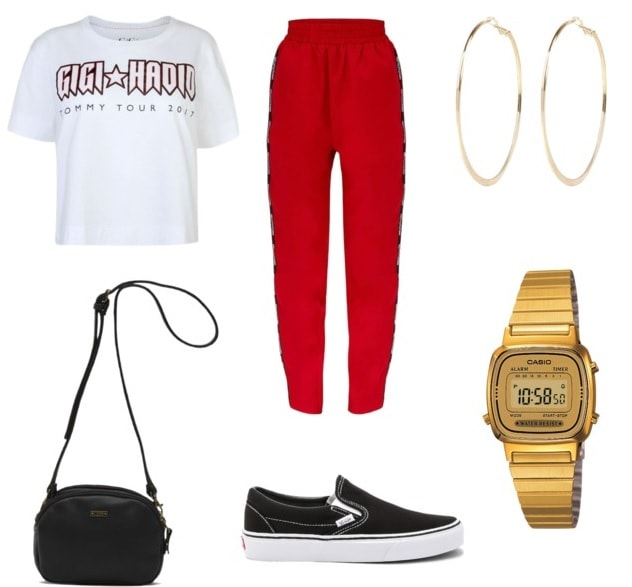 track pants going to class style with hoop earrings, gold watch, white graphic tee, black vans, and black shoulder purse.