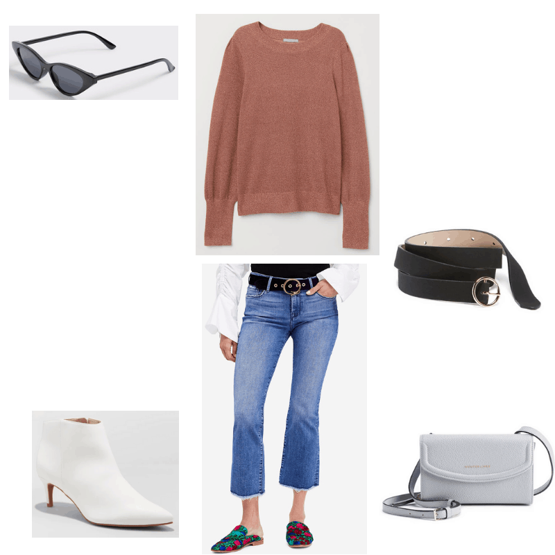 Outfit with pink sweater, frayed jeans, cat-eye sunglasses, o-ring belt, white kitten heel boots, and mini crossbody