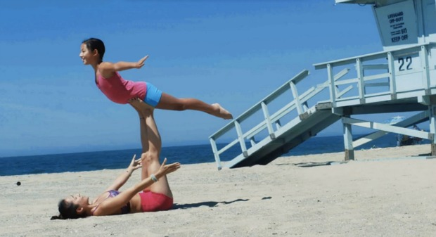 Two girls doing a pairs pose together