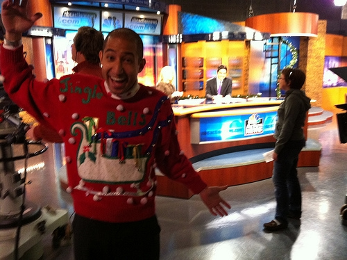 Guy wearing an ugly holiday sweater