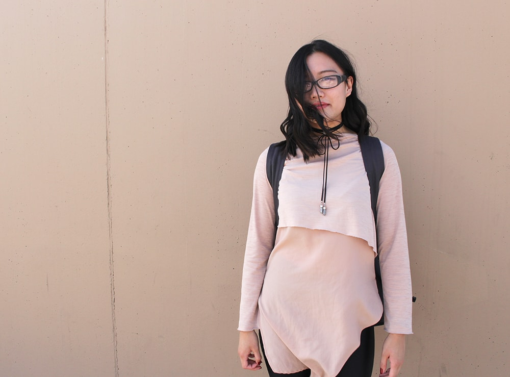 Pink layered asymmetrical top on campus at the University of Calgary